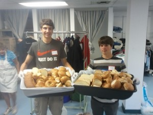 Mission Trip Serving Bread at Soup Kitchen