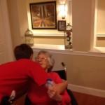 Mission Trip hugging resident