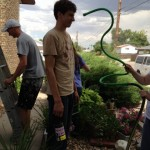 Mission Trip Painting, Cooling with a hose